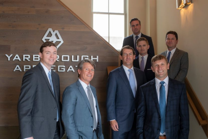 Yarborough Applegate attorneys standing in a staircase